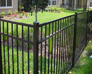 a black residential aluminum fence enclosing the houses for provide excellent security